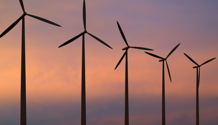Wind turbines against red sky Stock Photo