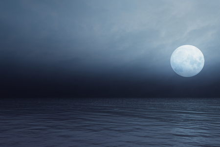 Full moon and transparent clouds over the sea Stock Photo
