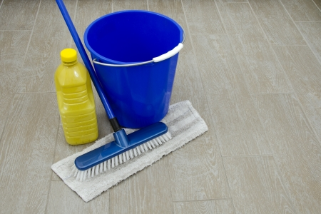 clean floor: some cleaning products for house  on  old floor Stock Photo