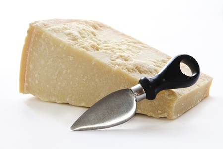 Parmisan cheese and knife in white background photo