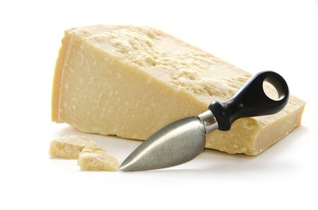 Parmisan cheese and cheese knife in white background