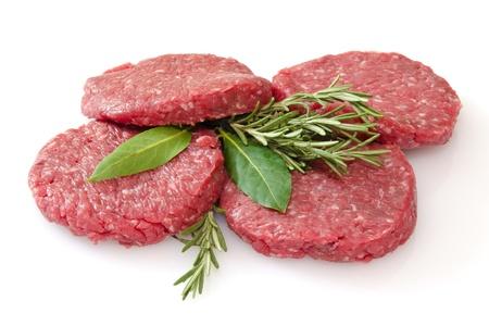 some raw hamburgers isolated on white background  Stock Photo