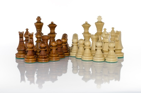 Wood chess sets in white mirror background Stock Photo - 16528291