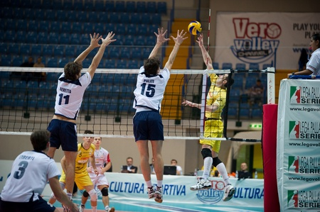 reggio emilia: MONZA, ITALY - NOVEMBER, 25  Curti   Yellow  against a white wall in Vero Volley  Monza   white   vs Conad Reggio Emilia    Yellow  -Italian Volley A2 League on 2012 Novermber, 25 in Monza  Italy