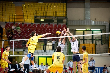 reggio emilia: MONZA, ITALY - NOVEMBER, 25  Diachkov   11, Yellow   take the ball over the net in Vero Volley  Monza   white   vs Conad Reggio Emilia    Yellow  -Italian Volley A2 League on 2012 Novermber, 25 in Monza  Italy  Editorial