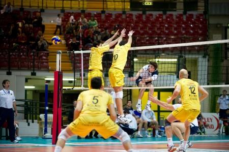 MONZA, ITALY - NOVEMBER, 25  L  Puliti   15 white  against  yellow wall in Vero Volley  Monza   white   vs Conad Reggio Emilia    Yellow  -Italian Volley A2 League on 2012 Novermber, 25 in Monza  Italy  Editorial