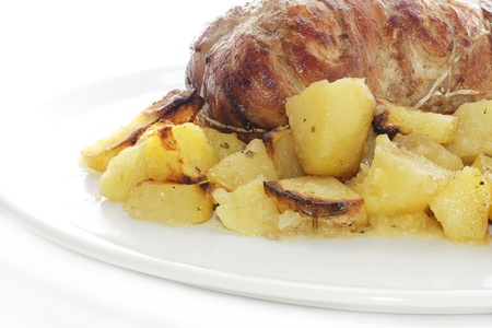 rolled veal stuffed with potatoes in white plate