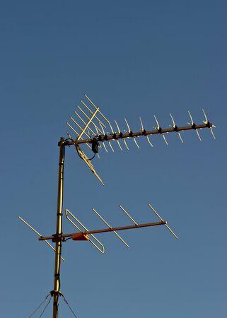 Home TV antennas against a blue sky Stock Photo - 17092530