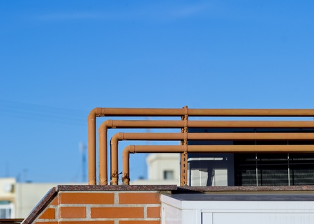 Orange pipelines on home roof photo