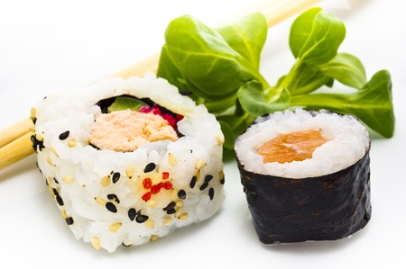 Delicious sushi rolls on white background  with chopsticks  Stock Photo