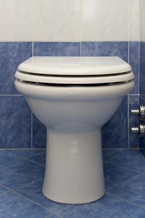 w c: white domestic water closed in blue bathroom