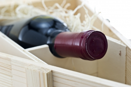 Bottle of old red wine in gift wooden box  photo
