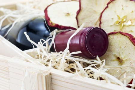 Bottle of old red wine in gift wooden box with apples Stock Photo - 17351788