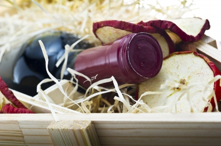 Bottle of old red wine in gift wooden box with apple