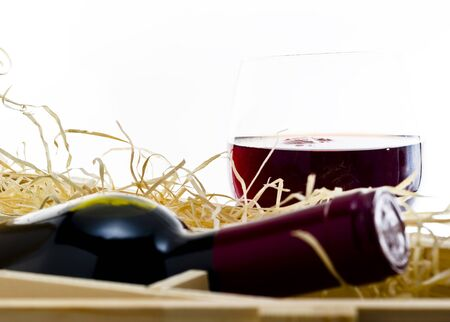 Bottle of old red wine in gift wooden box Stock Photo - 17351696