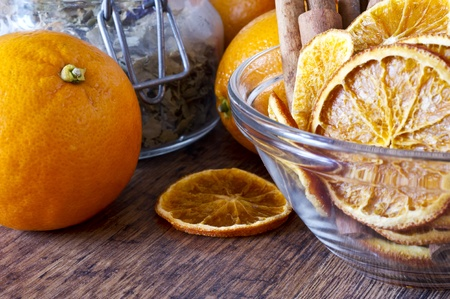 Dried orange and cinnamon sticks - christmas decoration on wooden table