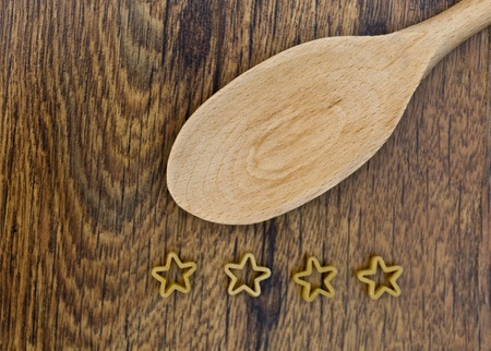 four stars pasta in wooden table Stock Photo - 17352075