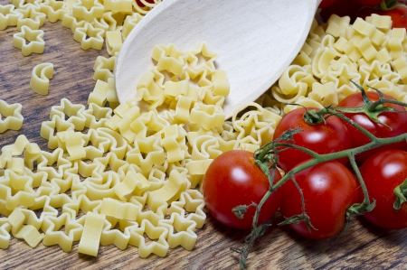 pasta stars and moon on wooden table Stock Photo - 17352042