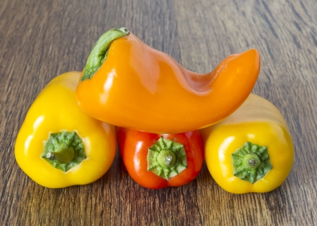 Mixed Peppers on wooden table