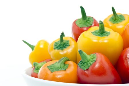 Mixed Peppers in white plate on white background Stock Photo - 17499704