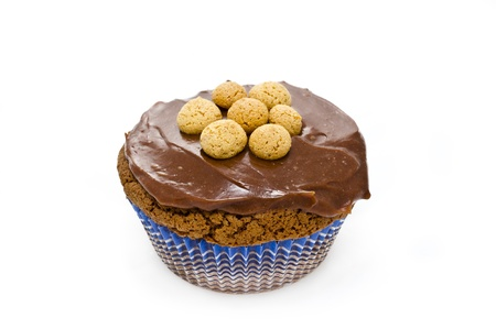 chocolate muffin with italian pastries called amaretti and cream isolated in white background