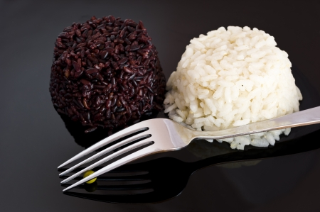 mixed rice  on black plate photo