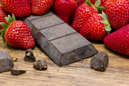 Strawberries  raw chocolate on wooden table photo