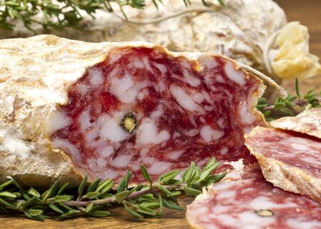 Slices of Salame from Italy on Wooden table Stock Photo