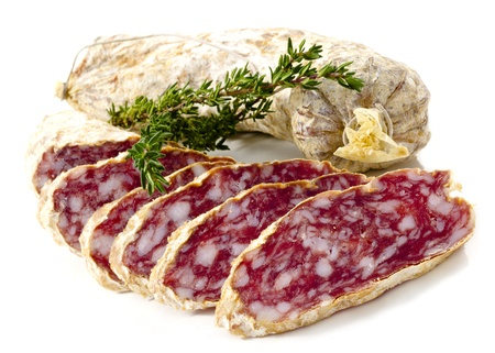 Slices of Salame from Italy on white background photo