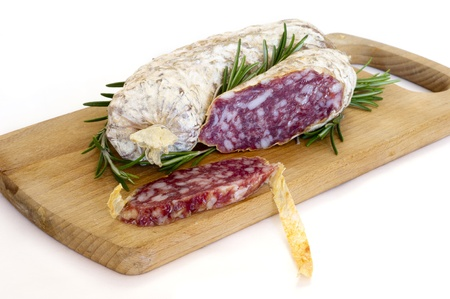 salame: Slices of Salame from Italy on Wooden table Stock Photo