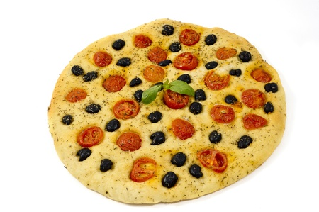 homemade focaccia with tomatoes, olives  and oregano on white background photo