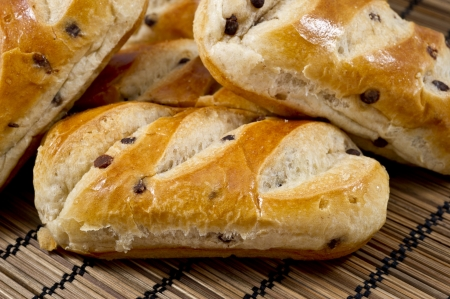 Several freshly baked  buns with chocolate chips  Stock Photo