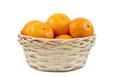 Tangerines (mandarin)  in a straw cup on white background