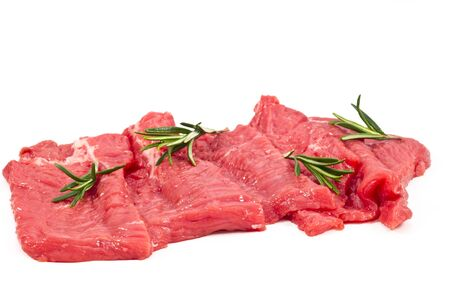 Raw fresh meat sliced  with rosemary in white background photo