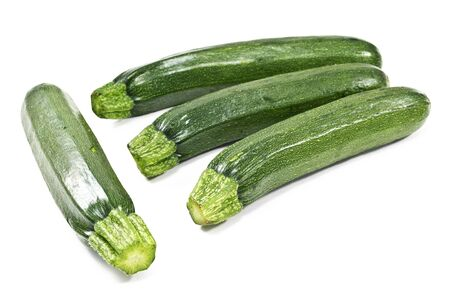 Fresh zucchini isolated on white background photo