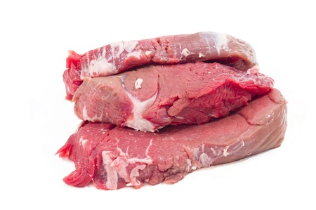fresh and raw beef steaks in white background photo