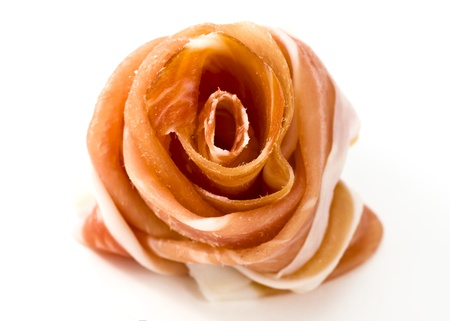 prosciutto crudo ham in white background - close up photo