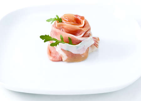 prosciutto crudo ham in white plate with salad photo