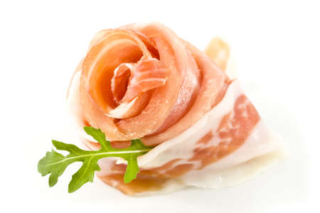 prosciutto crudo ham in white background - close up