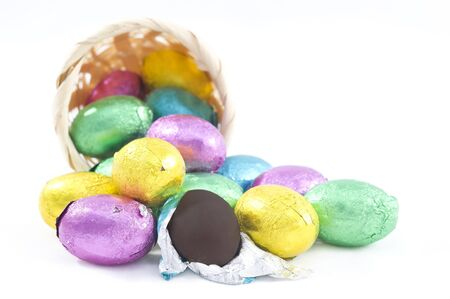 coated: Pastel candy coated Easter chocolates in white background