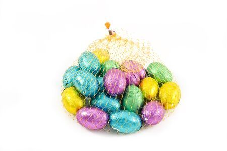 Pastel candy coated Easter chocolates in white  background photo
