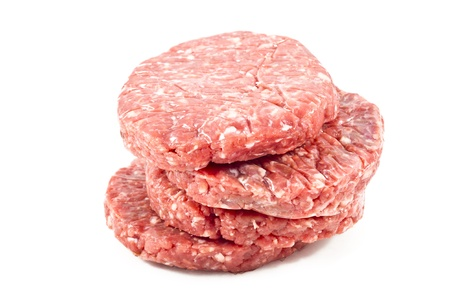 raw hamburgers with protective film in white background photo