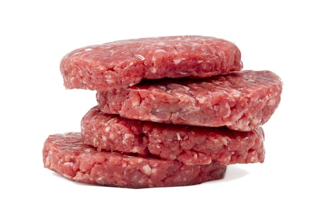 raw hamburgers with protective film in white background Stock Photo