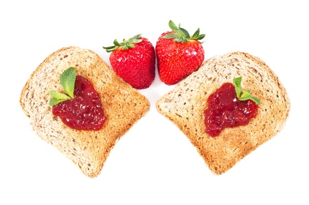 sweet strawberries jam on toast close up on white background photo