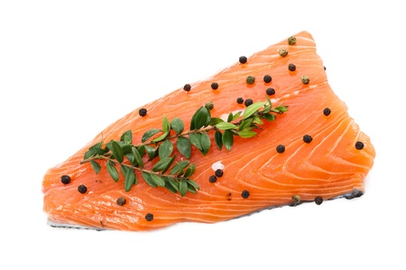 Fresh salmon fillet on white background  with pepper and herbs