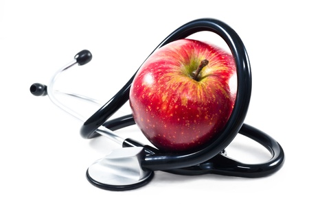 An apple with stethoscope on white background photo