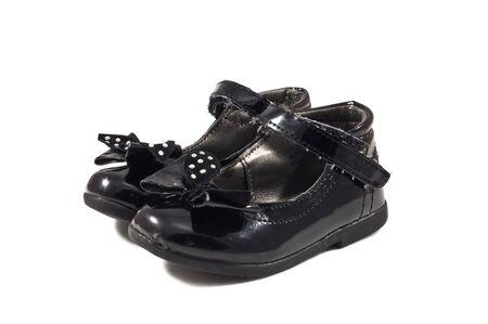 Used black child shoes isolated on white background