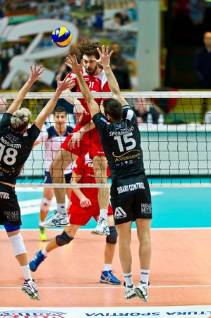 MILAN, ITALY - APRIL, 10    T  Beretta   11, red Monza  against Maretta and Sperandio   in A2M PLAY - OFF Vero Volley Monza -  Corigliano on April 10, 2013 in Milan, Italy