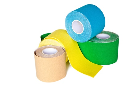 special physio tape rolling on white background photo