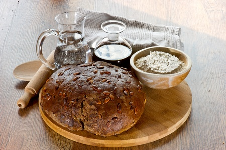 bread on wooden board with oil and wather on wooden table photo